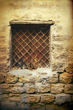 Irene Lamprakou WINDOW IN BRICK WALL WITH BARRED SHUTTERS Building Detail