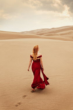 Buffy Cooper WOMAN IN RED DRESS WALKING IN DESERT Women