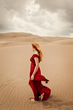 Buffy Cooper WOAN IN RED DRESS WALKING IN DESERT Women