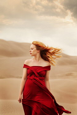Buffy Cooper THOUGHTFUL WOMAN IN RED DRESS IN DESERT Women