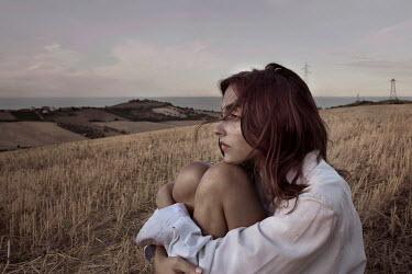 Elisa Paci THOUGHTFUL WOMAN SITTING IN COUNTRYSIDE Women