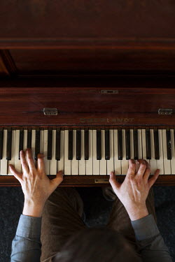 Holly Leedham MANS HANDS PLAYING WOODEN PIANO Body Detail