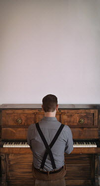 Holly Leedham VINTAGE MAN PLAYING WOODEN PIANO Men