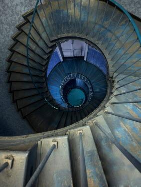 Jaroslaw Blaminsky SPIRAL STAIRCASE LEADING DOWNWARDS IN HALLWAY Stairs/Steps