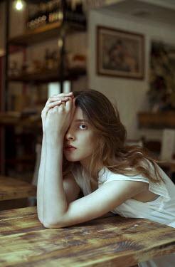 Elisa Paci YOUNG BRUNETTE WOMAN SITTING IN BAR Women