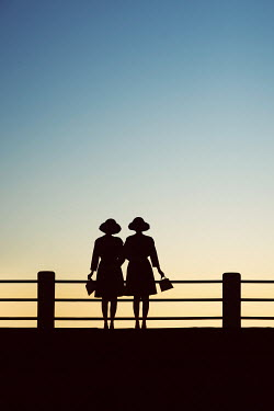 Susan Fox SILHOUETTE OF TWO WOMEN AT SUNSET Groups/Crowds