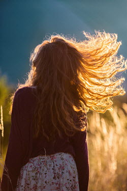 Nina Masic BRUNETTE WOMAN WITH HAIR IN SUNLIGHT Women