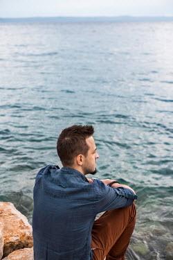Nina Masic THOUGHTFUL MAN SITTING BY SEA Men