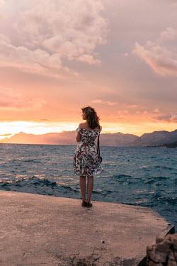 Nina Masic WOMAN WATCHING SUNSET AT SEA Women