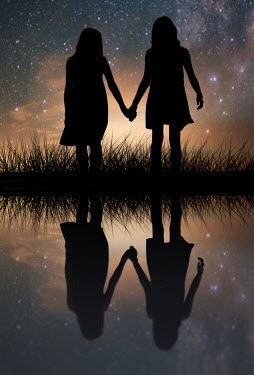 Elisabeth Ansley SILHOUETTE OF GIRLS REFLECTED IN LAKE AT NIGHT Children