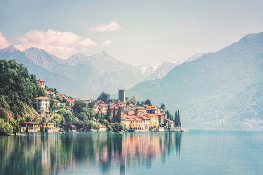 Evelina Kremsdorf village by mountains reflected in lake Villages