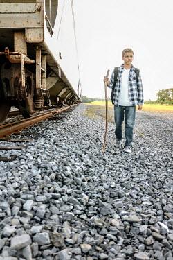 Stephen Carroll TEEN BOY WALKING BY TRAIN IN COUNTRYSIDE Children