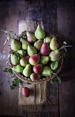 Jean Ladzinski GREEN PEAR FRUITS IN RUSTIC BASKET Miscellaneous Objects