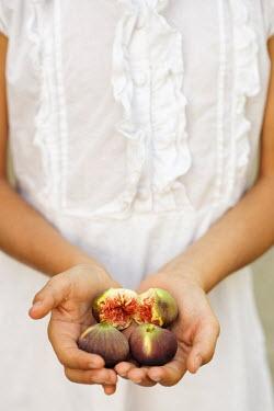 Krasimira Petrova Shishkova young girl holding figs Children