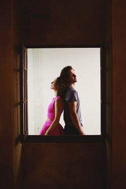 Anna Rakhvalova COUPLE STANDING BACK TO BACK  BY WINDOW Couples