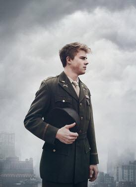 Mark Owen MAN IN WWII UNIFORM IN WINTRY CITY Men