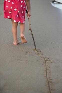 Galya Ivanova LITTLE GIRL DRAWING LINE IN THE SAND Children
