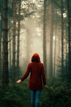 Rekha Garton WOMAN WEARING RED COAT IN FOREST Women
