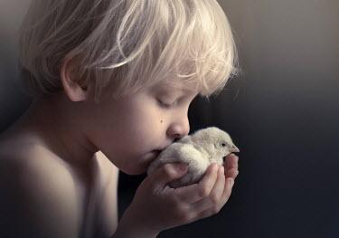 Sveta Butko LITTLE BLOND BOY KISSING FLUFFY CHICK Children