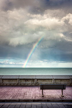 Evelina Kremsdorf BENCH OVERLOOKING RAINBOW AND CLOUDY SEA Seascapes/Beaches