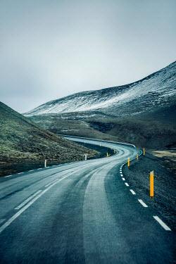 Evelina Kremsdorf EMPTY WINDING ROAD THROUGH MOUNTAINS Roads