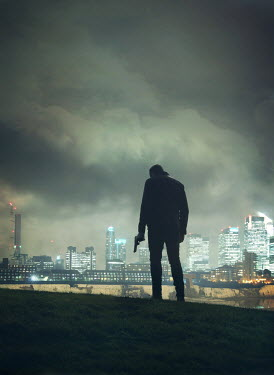 Mark Owen SILHOUETTE OF MAN WITH GUN IN FOGGY CITYSCAPE Men