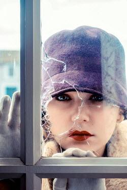 Elly De Vries WOMAN LOOKING THROUGH BROKEN WINDOW Women