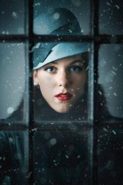 Ildiko Neer Retro woman behind the window at winter Women