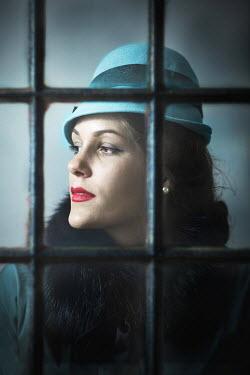 Ildiko Neer Retro woman behind the window Women