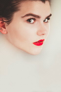 Laura Ranftler WOMAN WITH RED LIPS IN MILKY WATER Women