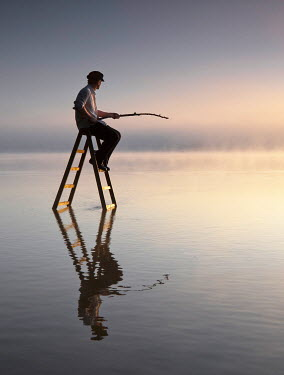 Leszek Paradowski MAN FISHING ON LADDER IN SEA Men