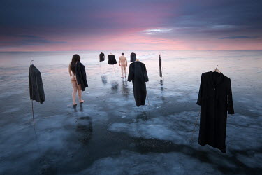 Leszek Paradowski SURREAL NAKED COUPLE WITH HANGING CLOTHES ON FROZEN LAKE Couples