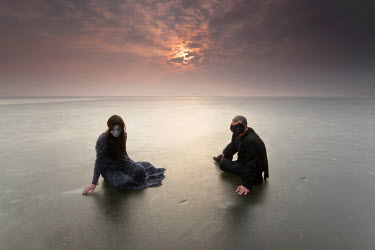 Leszek Paradowski SURREAL COUPLE WITH MASKS ON REMOTE BEACH Couples