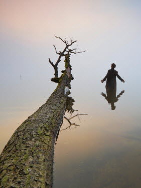 Leszek Paradowski MAN IN WATER WITH FALLEN TREE Men