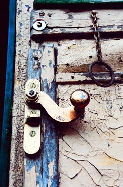 Ute Klaphake OLD DOOR WITH HANDLE AND PEELING PAINT Building Detail