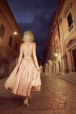 ILINA SIMEONOVA RETRO BLONDE WOMAN WALKING IN HISTORICAL CITY Women