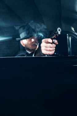 Ysbrand Cosijn RETRO MAN SHOOTING GUN FROM CAR AT NIGHT Men