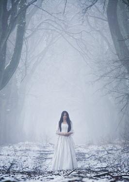 Leszek Paradowski WOMAN IN WHITE IN SNOWY, FOGGY FOREST Women