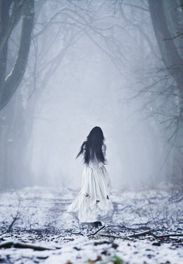 Leszek Paradowski WOMAN IN WHITE IN FOGGY, SNOWY FOREST Women