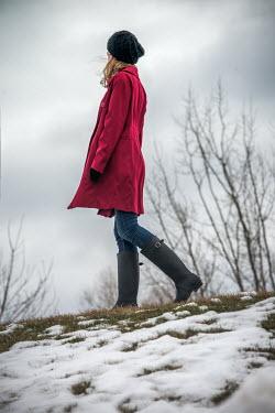 Elisabeth Ansley WOMAN IN RED COAT WALKING IN SNOW Women