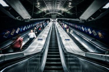 Evelina Kremsdorf commuter people on London Tube escalators Groups/Crowds