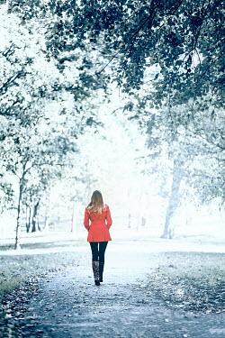 Evelina Kremsdorf WOMAN IN RED COAT WALKING IN WOODS Women