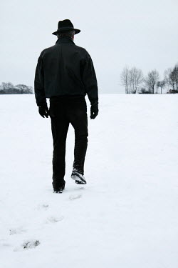 Ilona Wellmann MAN WALKING IN SNOWY FIELD Men