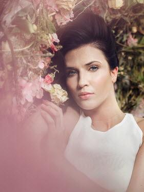 Michal Zahornacky BRUNETTE WOMAN LYING WITH SUMMER FLOWERS Women