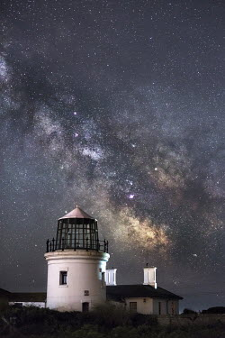 Ollie Taylor LIGHTHOUSE AT NIGHT WITH STARRY SKY Miscellaneous Buildings