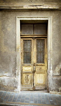 Vesna Armstrong OLD DOOR IN WEATHERED BUILDING Houses