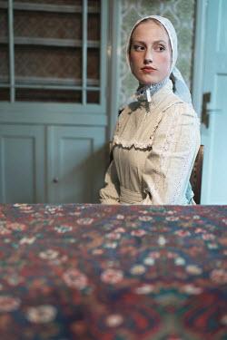 Ysbrand Cosijn HISTORICAL WOMAN IN WHITE SITTING IN HOUSE Women