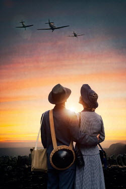 Lee Avison 1940s couple watching warplanes flying at sunset Couples