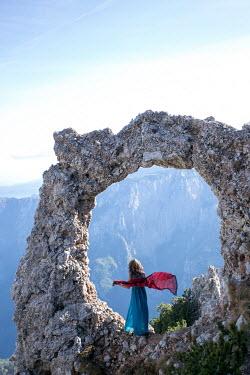 Aida Redzepagic WOMAN STANDING IN STONE CIRCLE WITH MOUNTAINS Women