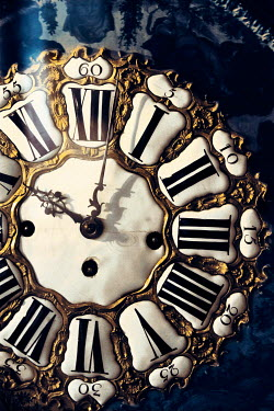 Ute Klaphake CLOSE UP OF ORNATE ANTIQUE CLOCK Miscellaneous Objects